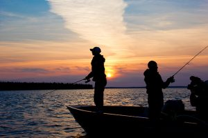 Cree-Lake-Lodge-Sunset-with-people-fishing
